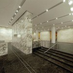 The feature wall and desk is a marble called Breccia Capraia.