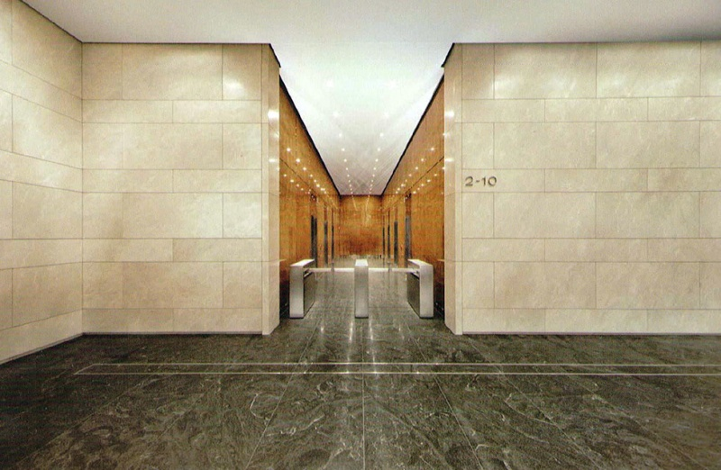 The beige walls are a marble called Crema Marfil