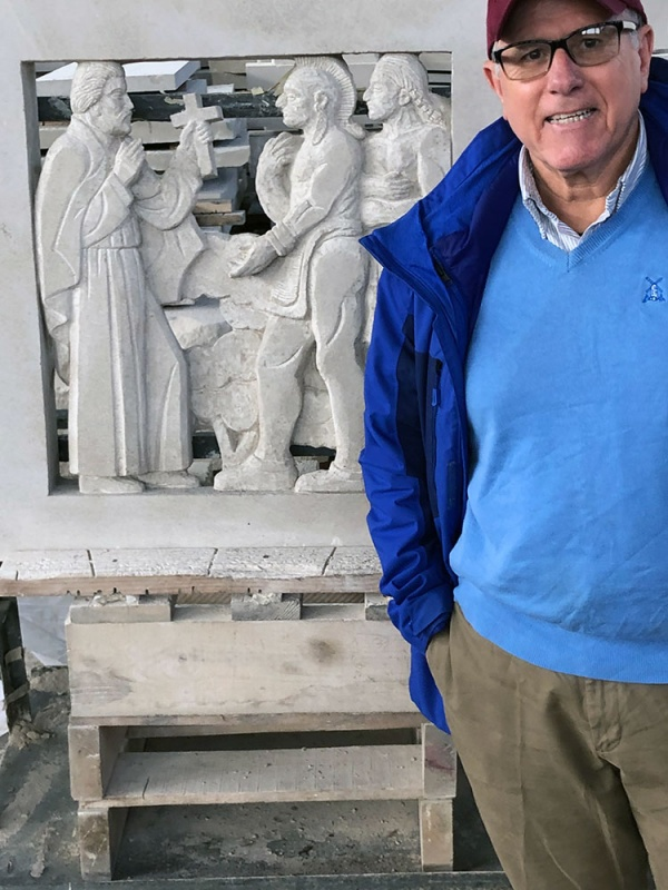 Ralph Petrillo in front of a stone carving